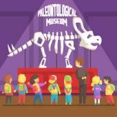 Fotografia Groop di bambini della scuola In Museo di paleontologia accanto al triceratopo scheletro