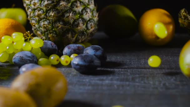 Grapes Falls and Splatters on Table with Fruits