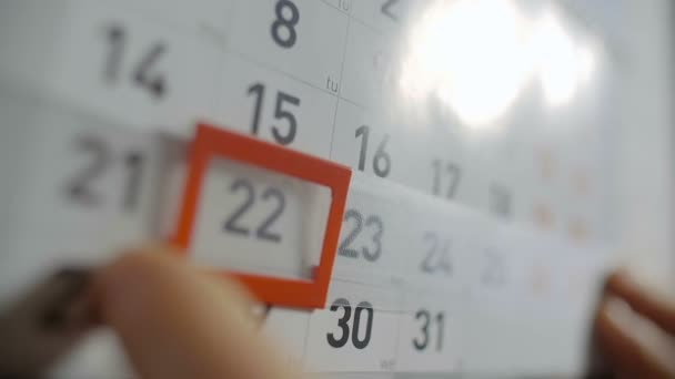 The Hand Moves Date Pointer on Calendar