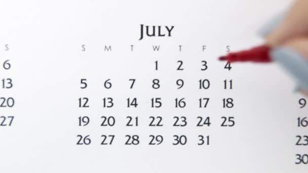 Female hand circle day in calendar date with a red marker. Business Basics Wall Calendar Planner and Organizer. July 3th