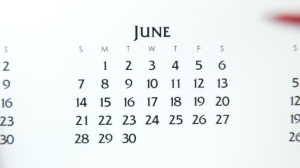 Female hand circle day in calendar date with a red marker. Business Basics Wall Calendar Planner and Organizer. June 4th