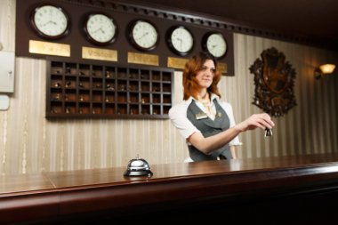 Hotel receptionist and counter desk with bell