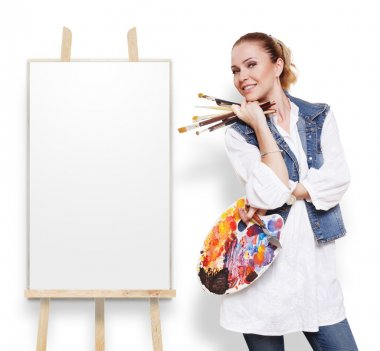 Woman artist with brushes, palette and copy space