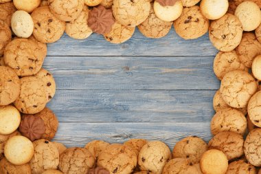 Cookies and biscuits at blue wood with copy space