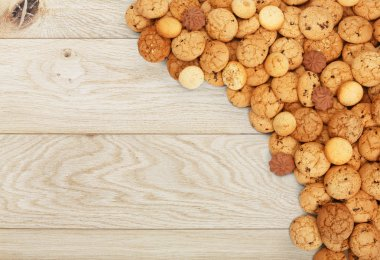 Cookies and biscuits at natural wood with copy space