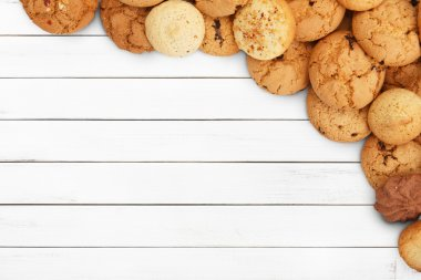 Cookies and biscuits at white wood with copy space