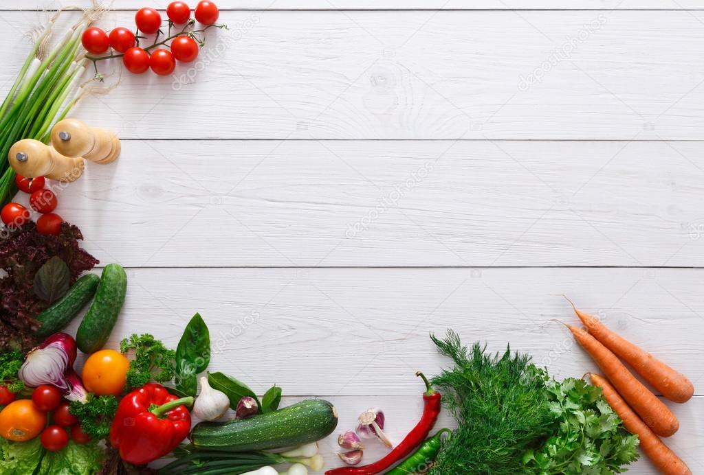 Fresh vegetables frame on white wooden background with ...