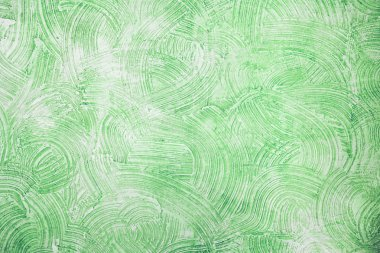Decorative green plaster texture on the wall - background