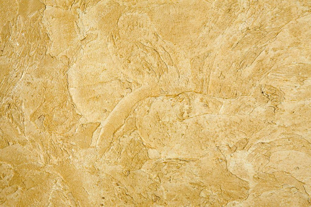 Decorative golden plaster texture on the wall - background — Stock ...