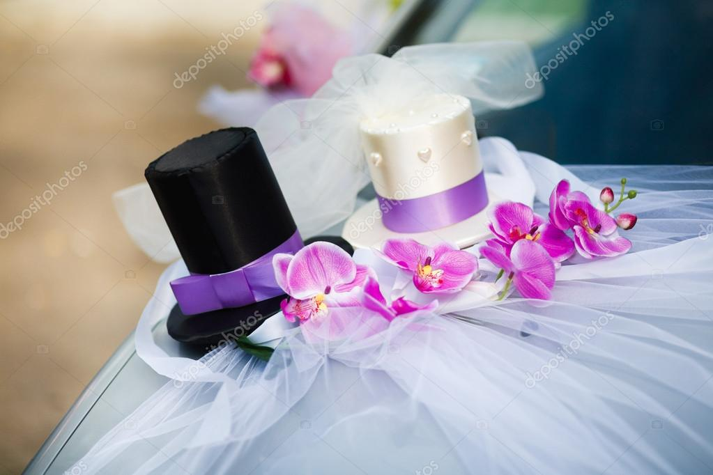 Wedding car decoration with two top hats