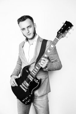 Male musician holding electric guitar