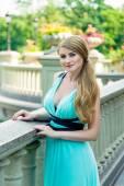 Fotografie woman wearing sexy blue dress