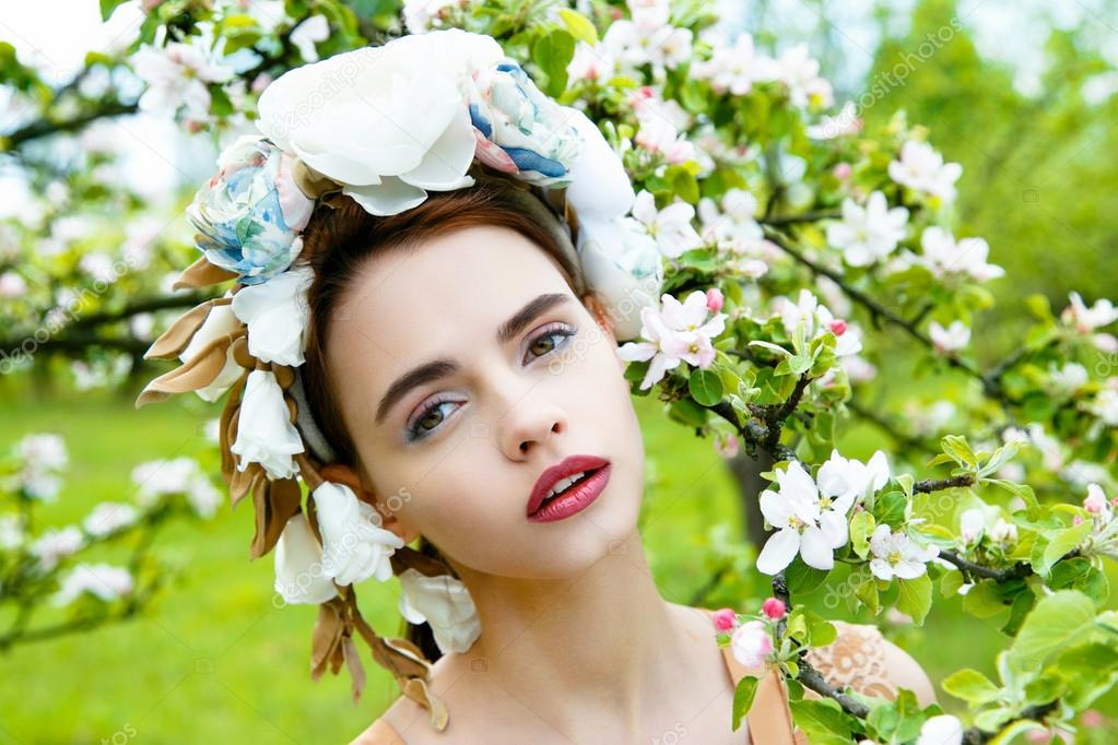Sensual woman in floral wreath