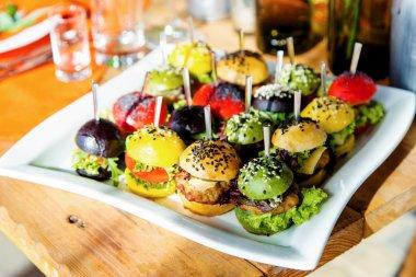 Tasty Burgers on plate