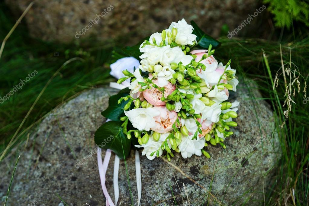 Wedding bouquet on rock
