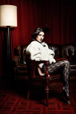 Woman in  victorian chair