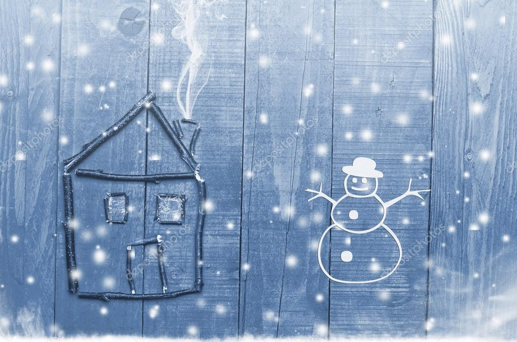 House arranged from twigs on wooden winter snowy blue background. Snowman.