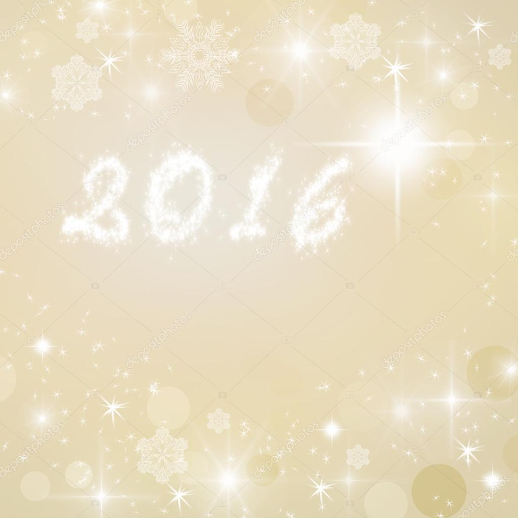 year 2016 written on gold bright sparkly winter background new year card stock