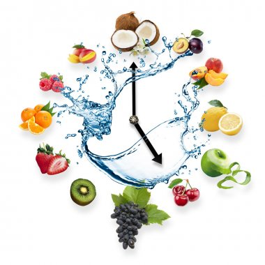 Clock arranged from healthy fruits splash by water isolated on white background. Food clock with fruits. Healthy food concept.