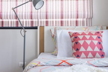 modern lamp in modern bedroom with colorful pillow
