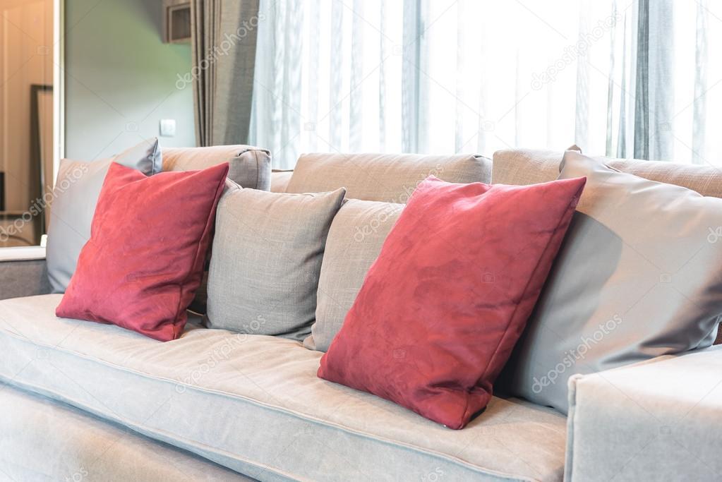 red pillows on modern grey sofa — Stock Photo © khongkitwiriyachan ...