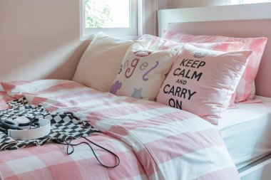 Pink color tone bedroom design with pink pillows