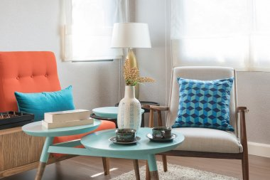 Colorful pillows and round table in modern living room