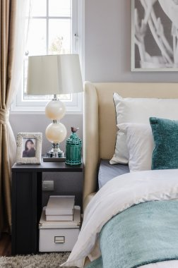 modern interior bedroom with table and lamp