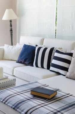 Large white sofa with lamp in living room