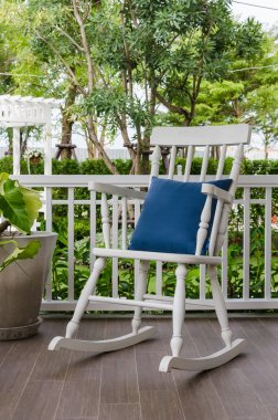 white wooden rocking chair on front porch