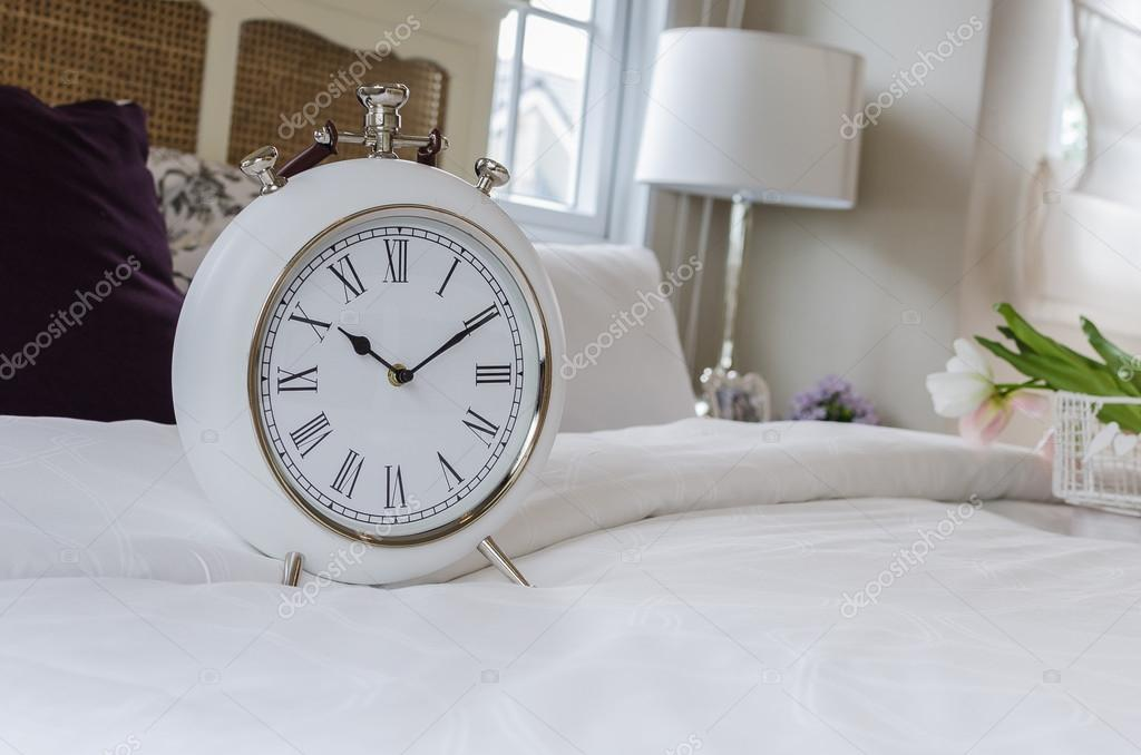 Classic White Alarm Clock Style In Classic Bedroom At Home U2014 Photo By  Khongkitwiriyachan