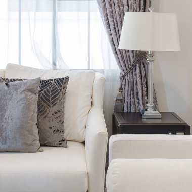 brown pillows on sofa in luxury living room