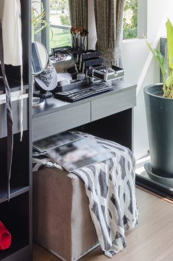 black dressing table with brown chair