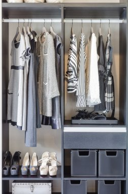 black and white clothes in black closet