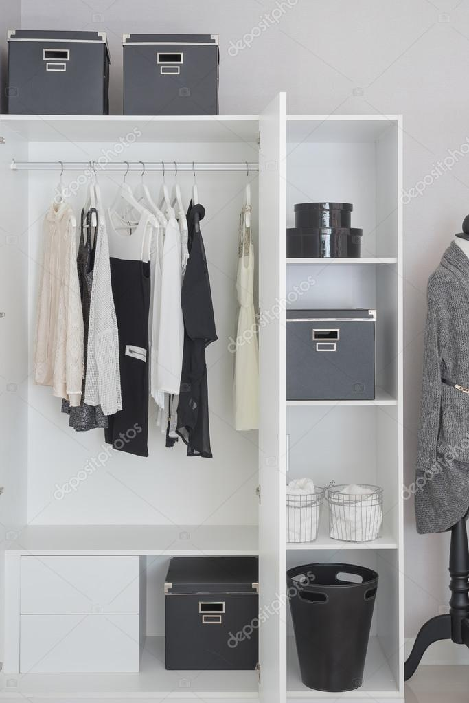 Black and white clothes hanging in wardrobe