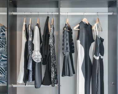 black and white clothes hanging in closet