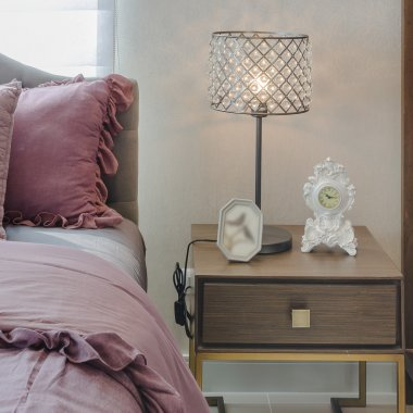 Classic lamp style on wooden table side in bedroom