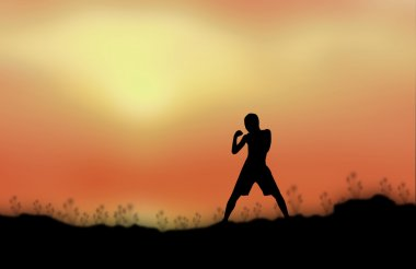 Silhouette man fight Sunset background