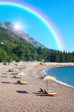 Sandy beach, sunny days, rainbow landscape and the Adriatic Sea