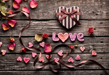 Word Love with heart shaped gift box