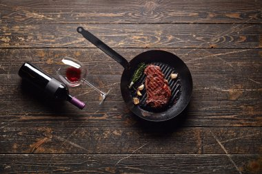 Marbled beef steak with wine bottle