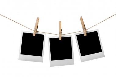 Three instant photos on the clothesline