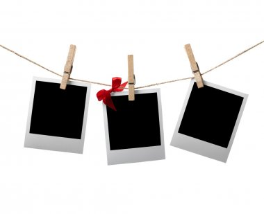 Instant photos with red bow on the clothesline
