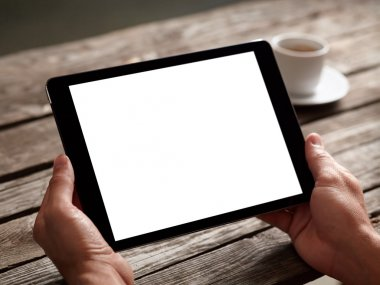 tablet computer in male hands