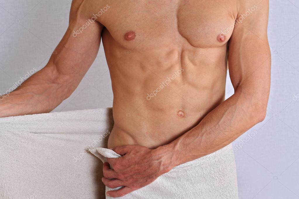 Muscular male torso, chest and armpit hair removal close up. Male Brazilian Waxing treatment