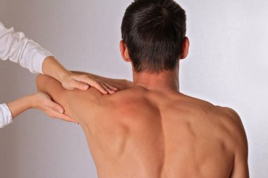 Chiropractic, osteopathy, dorsal manipulation.Therapist doing healing treatment on man's hand. Alternative medicine, pain relief concept