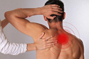 Chiropractic, osteopathy, manual therapy.Therapist  doing healing treatment on man's back. Alternative medicine, pain relief concept