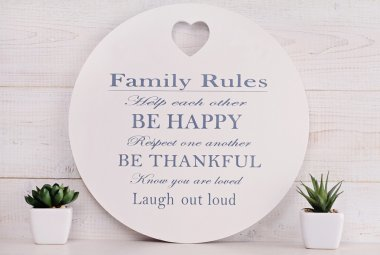 Happy family, Love and togetherness concept. Family rules sign.