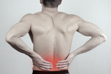 Man with  back pain. Man rubbing his painful back close up. Pain relief concept