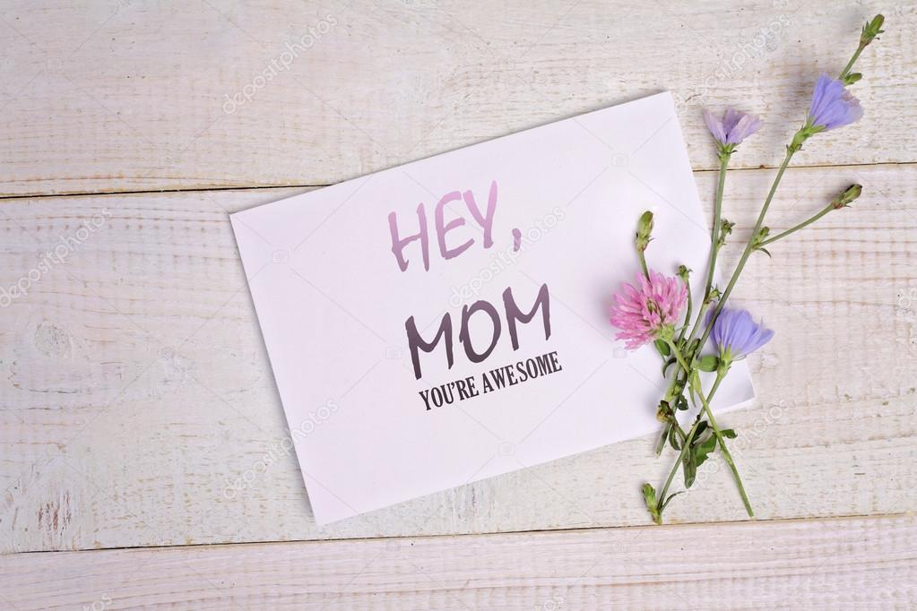 Hey Mom Your Are Awesome Message Card And Bouquet Of Flowers On Rustic Wooden Table Funny Valentine For Mother Birthday Mothers Day